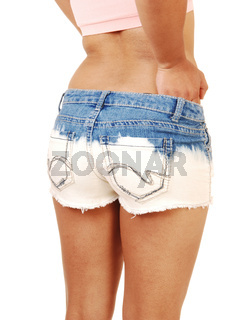 The bottom of a woman in jeans shorts