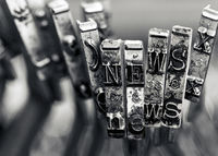 the word NEWS with old typwriter hammers macro image