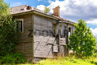 Abandoned and destruction old rural wooden house in russian village
