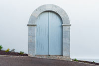 Light blue arched door