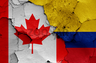 flags of Canada and Colombia painted on cracked wall