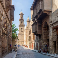Moez Street with minaret of Qalawun Complex historic building, Cairo, Egypt