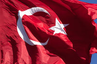 Turkish flag waving in wind at sunny day