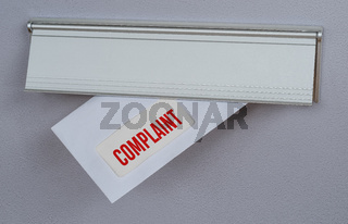 A letter in a mail slot - Complaint
