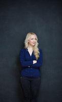 Blond woman in shirt against chalkboard, copyspace