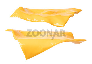 pieces of cheddar cheese on a white background