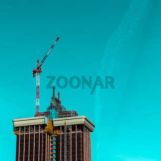 he renovation of the Tower of Colon against blue sky in Madrid