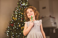 Smiling girl in festife dress at New year celebration