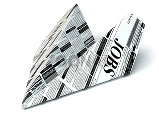 Job seeking concept. Newspaper as paper airplane.
