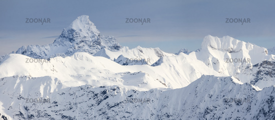Amazing Winter Panorama with the snow covered Mountains Hochvogel, Hofats, Krottenkopf in Allgau Alps, Bavaria, Germany.