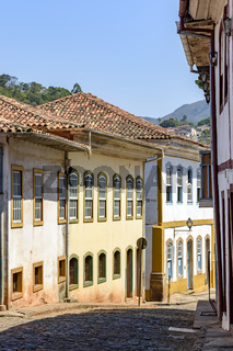 Beautiful street with old colorful houses in colonial architecture, cobblestones and lanterns