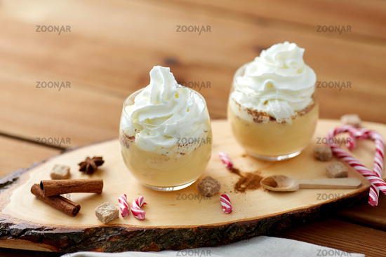 glasses of eggnog with whipped cream and anise
