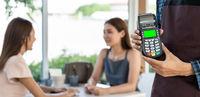 Panorama Close up Waiter hand hold credit card reader