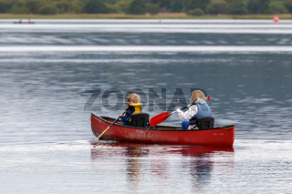 Mother and child canoeing on Loch Insh