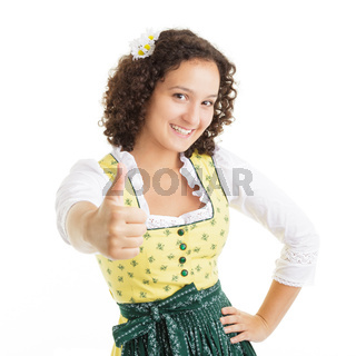 Young Dirndl pointing with thumbs up