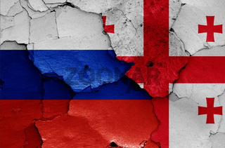 flags of Russia and Georgia painted on cracked wall