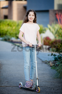 Girl Posing Outdoors with a Scooter