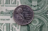 Symmetric composition of US dollar bills and a quarter of U.S. Virgin Islands