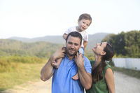 Happy family on countryside background