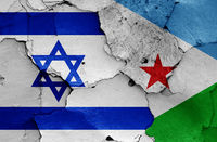 flags of Israel and Djibouti painted on cracked wall