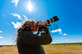 Woman photographer shooting the sky