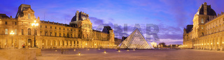 Panoramic image of the Musee du Louvre at dusk