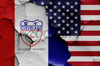 flags of Cleveland and USA painted on cracked wall