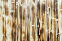 Old burnt wooden plank brown background with vertical boards