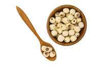 Dried lotus seeds in wooden bowl and wooden spoon on white background with clipping path. Nowadays lotus seed become popular healthy food and has highly beneficial for health.