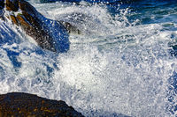 Detail of wave breaking over stones
