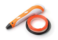 Orange 3D pen and set of filaments