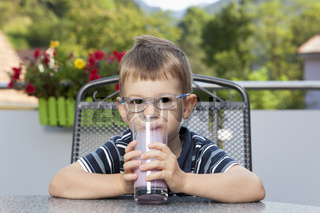 Little boy sipping milk drink