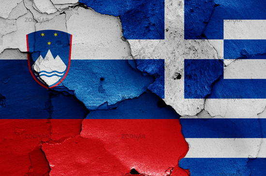 flags of Slovenia and Greece painted on cracked wall