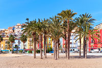 Villajoyosa sandy beach with coloful houses and palm trees. Spain