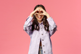 Found my true love, soulmate. Lively charismatic beautiful korean girl spot something lovely, look at camera from heart sign and smiling happy, being romantic and silly, pink background