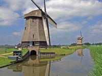 Windmills at a canal in the Netherlands