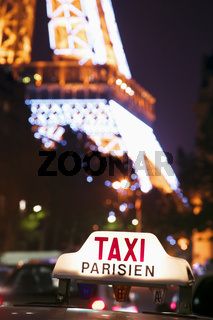 Taxi cab sign and Eiffel Tower .jpg