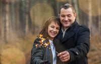 Happy couple hugging in winter park