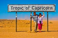 Happy elderly couple of tourists