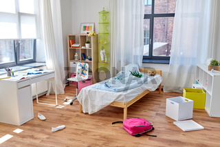 messy home or kid's room with scattered stuff