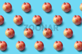 Fresh natural organic apples pattern on a blue background.