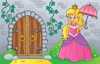 Princess with umbrella by old door