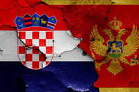 flags of Croatia and Montenegro painted on cracked wall