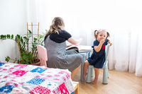 Grandmother and granddaughter playing together at home