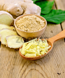 Ginger powder and grated on board with root and leaves