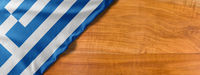 National flag of Greece on a wooden background with copy space