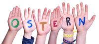 Children Hands Building Ostern Means Easter, Isolated Background