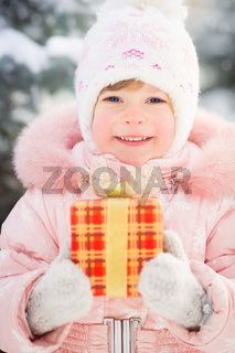 Happy child holding gift box