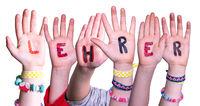 Children Hands Building Word Lehrer Means Teacher, Isolated Background