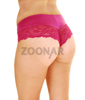 The butt of a woman in burgundy panties from the back